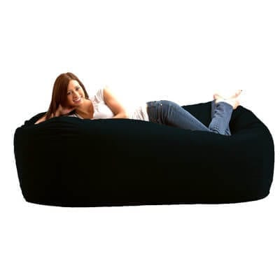 woman on large bean bag bed