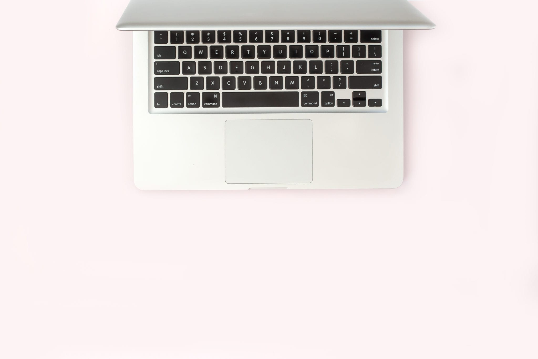 Long Island Blogging Services - 7 Steps to Blog Writing Success - Laptop on pink backdrop