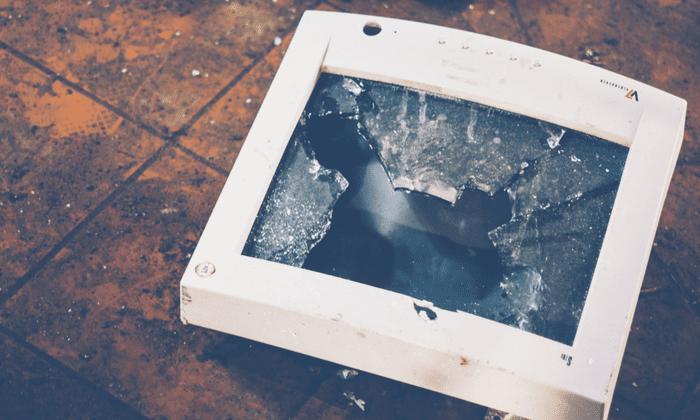 broken computer monitor thrown to the ground